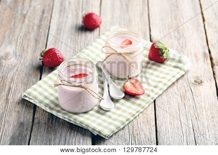 Strawberry Yogurt In Glass On A Grey Wooden Table
