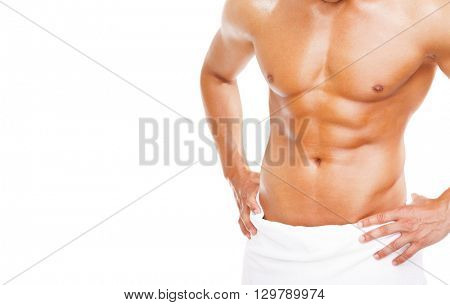 Fit young man in towel, isolated on white background
