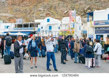 Santorini, Greece - May 2, 2016: Meeting tourists at the dock in the sea port of Santorini Athinios. Santorini is part of the five most visited tourist destinations in the world.