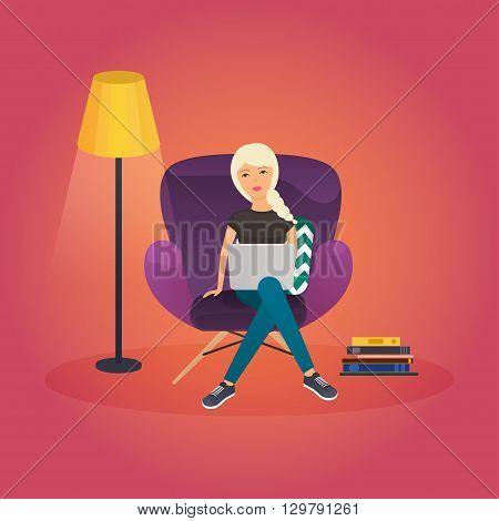 Girls working at home. Young woman sitting on a chair and using laptop at home. Freelance work from home self employed home office work at home freedom in living room. Work at home concept.