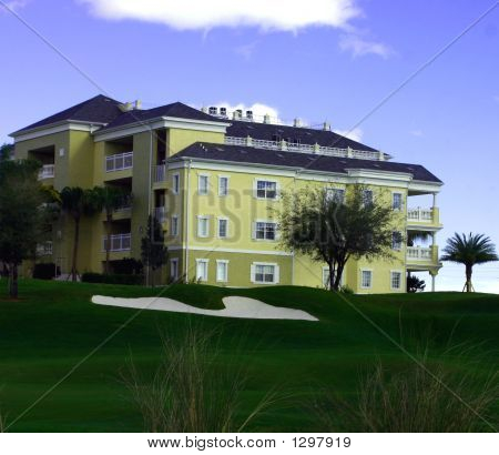 Landscaping At Golf Resort With Yellow Resort Hotel