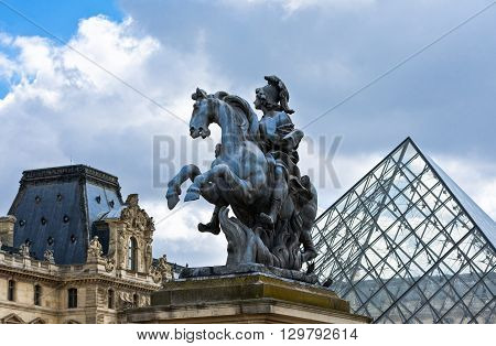 Paris France - August 29 2011: Louvre area Place du Carrousel the monument of Louis XIV.