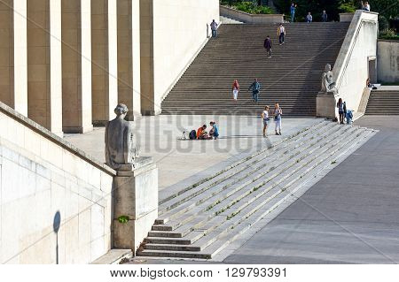 Paris France - August 30 2011: Tourists between the statue of the Trocadéro Esplanade stairways.