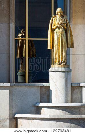 Paris a golden statue of the Trocadéro Esplanade.