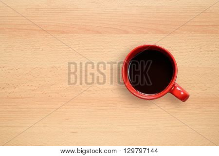 Red coffee cup on wooden desktop background
