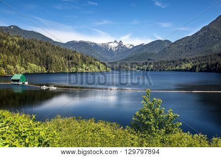 Capilano Reservoir Lake Long Reflection Green Building Dam Snowy  Snow Mountains Vancouver British Columbia Pacific Northwest