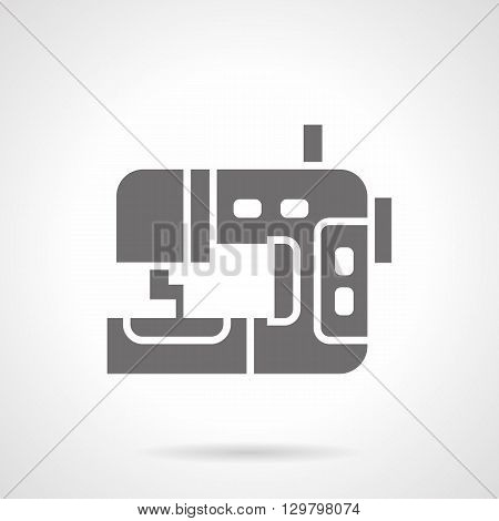 Equipment for garment factories. Industrial sewing machine, professional machines. Manufacture fashion clothing.  Symbolic black glyph style vector icon.