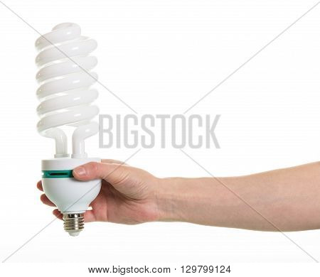 Hand holding spiral fluorescent lamp isolated on white background.