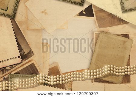 Old vintage archive with photos letters and pearls