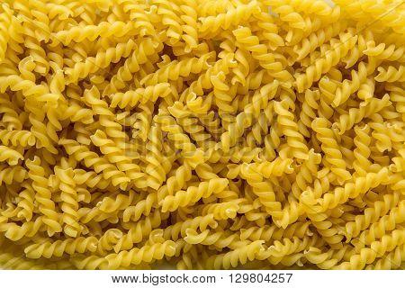 dry curly egg noodlesa large nu mber of close-up background