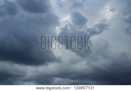 Dramatic thunderclouds over horizon dark gray. Stormy sky rain.