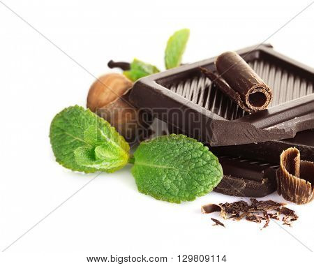 Chocolate with mint and hazelnuts on white background