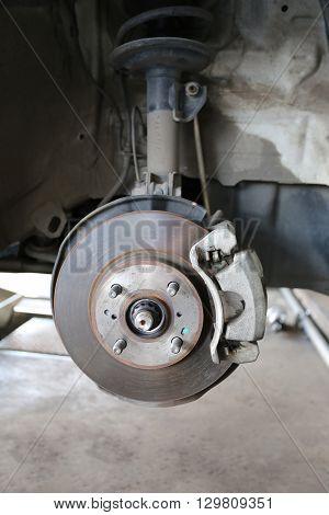 Wheel hub of a car in repair of the damageGarage shop.