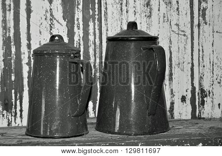 Old enameled metal coffee pots with lids