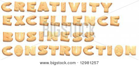 The words: creativity, excellence, business, construction made of cookies