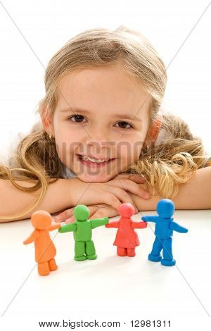 Little Girl Smiling With Her Clay People Family
