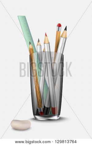 stationery set pencil, eraser and ruler to the glass