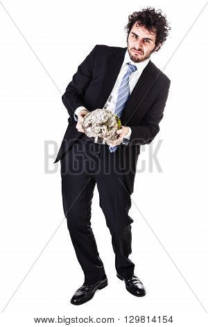 a businessman wearing a suit and a tie holding a heavy rock isolated over a white background