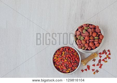 Bowl with dog food on the floor