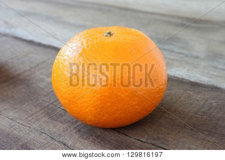 fresh orange fruit placed on wooden floor in concept of healthy eating.