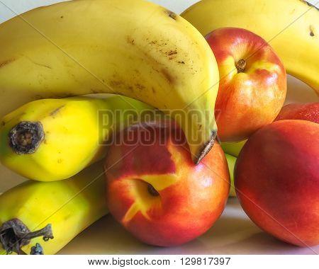 Some mixed fresh fruit - bananas and nectarines.