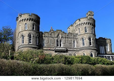 Historic English house with castle turrets, Scarborough, England.