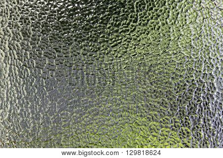 Stained glass background with dark and bright parts