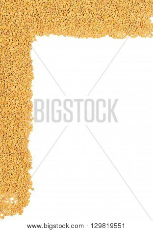 Whole unprocessed fenugreek (Trigonella foenum-graecumcumin) seeds border on white background