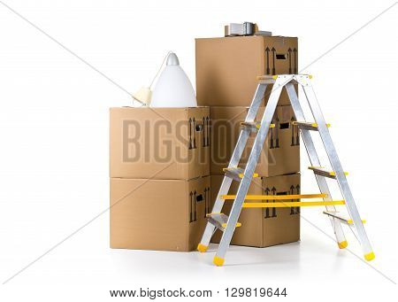 Ladder with stack of moving carton boxes over white background