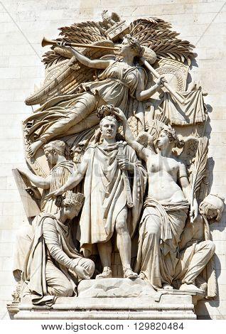 Carvings and statues on the walls of the landmark Arc de Triumph, Paris, France.