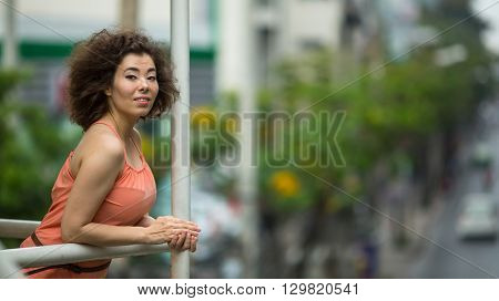 Beautiful Young Asian girl is standing on the overpass.