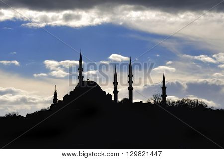 Istanbul Suleymaniye mosque silhouette light play of sun and cloud shadow skyline.Kanuni Sultan Süleyman mosque.