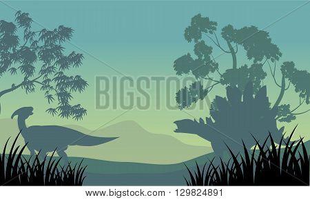 Dinosaur eoraptor and stegosaurus of silhouette scenery