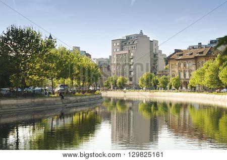 Bucharest, ROMANIA - April 22 2016: Traffic and Dambovita river in Izvor area, near the Parliament building. BUCHAREST -April 22 2016