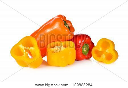 fresh Aura sweet red yellow and orange pepper on white background