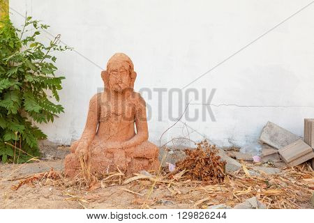 the cremation of a temple this old worn Buddha