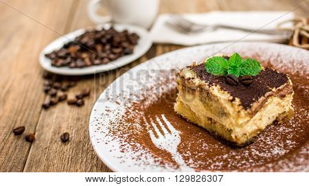 Traditional italian dessert tiramisu cream on wood table