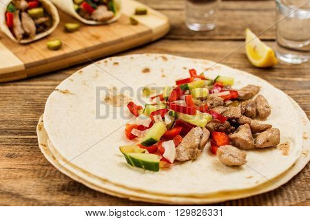Traditional mexican tortilla wrap with meat and vegetables