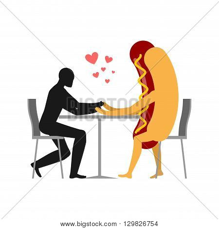 Lover In Coffee Room. Man And Hot Dog Is Sitting At A Table. Food In Restaurant. Fast Food In  Dinin