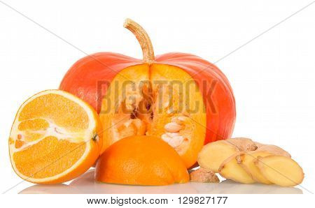 Ripe pumpkin, orange and ginger isolated on a white background.