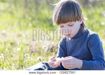 Child Sits And Thinks