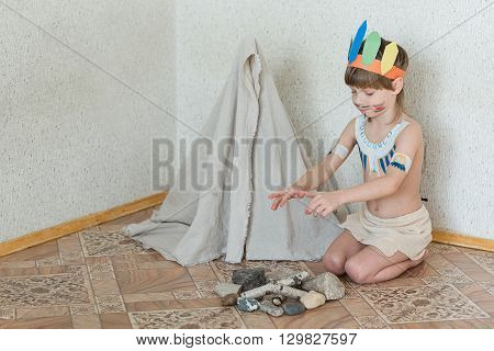 Blond Boy Playing Injun