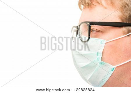 the surgeon's face with glasses and mask isolated close-up and space