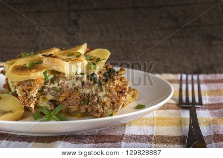 Moussaka on white plate - a traditional Greek dish