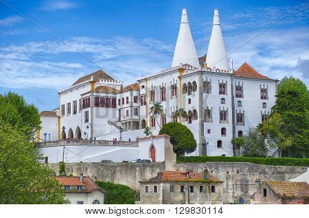SINTRA, PORTUGAL - May 1 2015: The National Palace in Sintra is a national landmark. With the two tall white kitchen chimneys it was the royal family's country palace away from Lisbon.