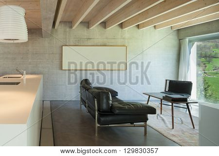 Interior of a modern chalet in cement, living room
