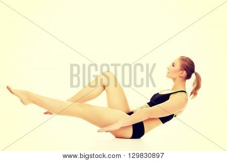 Young woman doing exercise on the floor