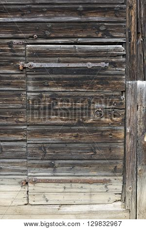 Detail of the old and dameged wooden door