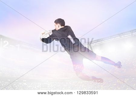 double exposure photo of stadium and soccer or football goalkeeper is catching ball