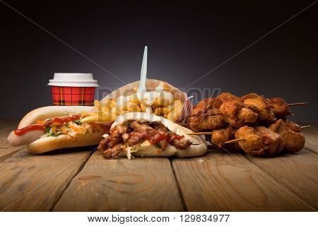 Pita hot-dog chicken bbq with cup of coffee on wooden table